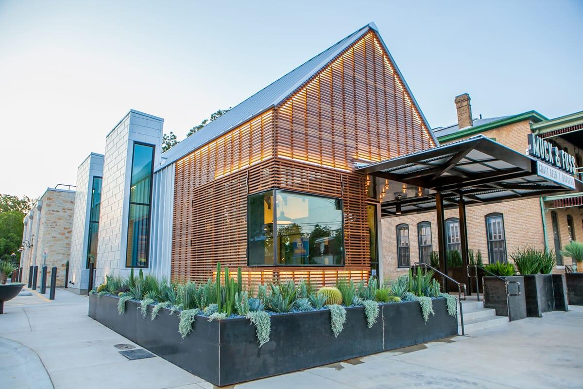 Muck & Fuss custom landscape design by LUSH Greenscape Design in New Braunfels, TX